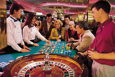 People and Groupier around the Roulette Table